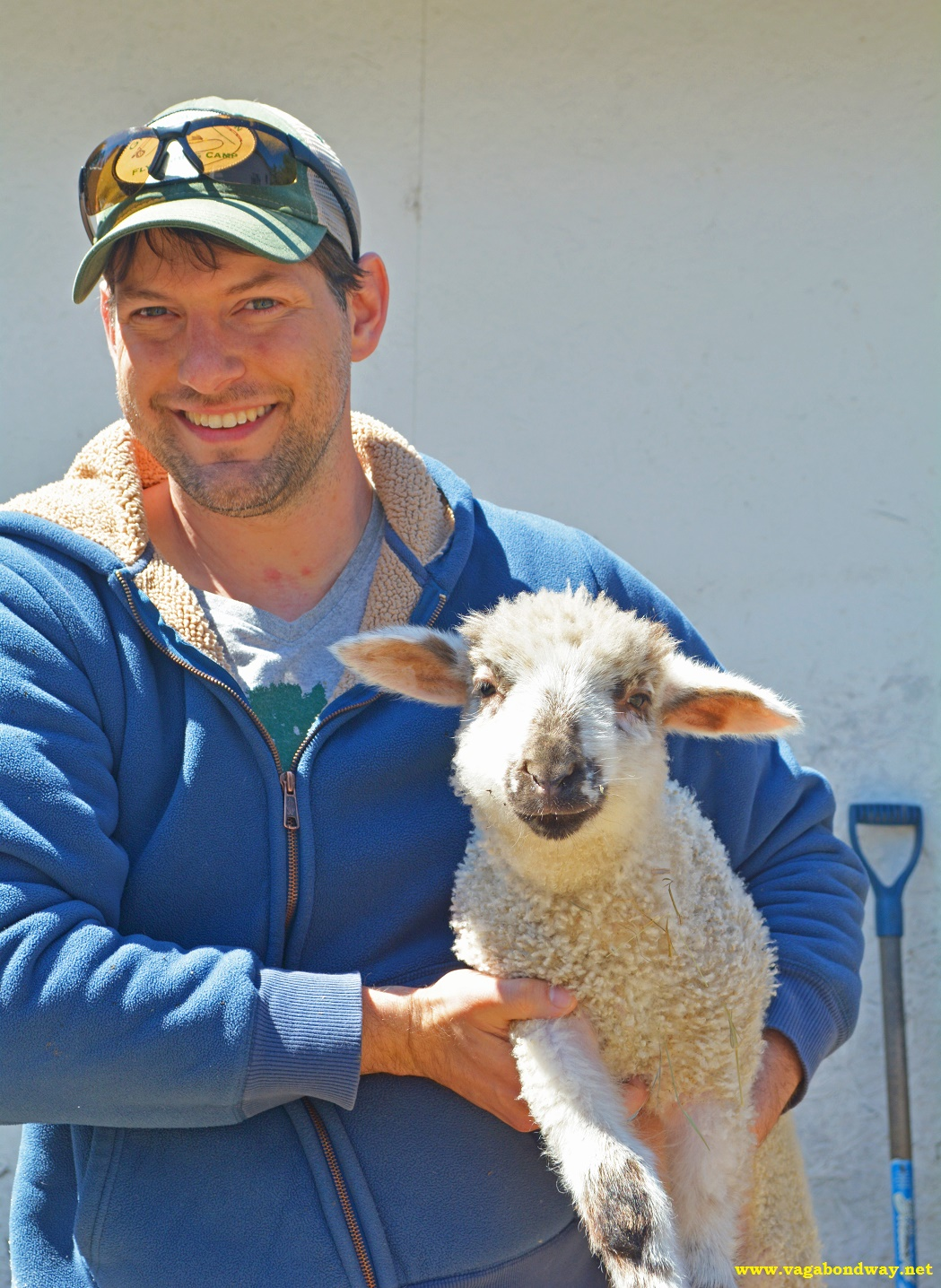 Chris with Lamb for travel adventure